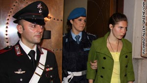 Amanda Knox is led into the court in Perugia Friday