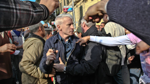 Pro-Mubarak demonstrators attack journalists T1larg.anderson.cooper.cnn