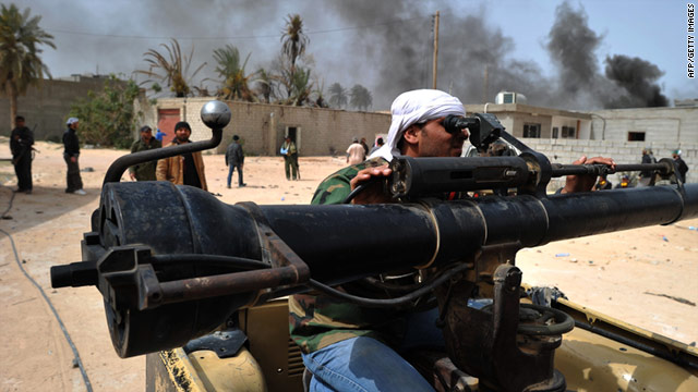Witnesses say fighting rages outside Misrata, shelling along port