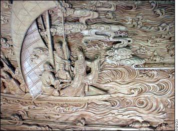 Detail of a wood carving of Jesus Calming the Waters, by Chinese artist  Zhang Wan-Long. Click for wider version of the carving.