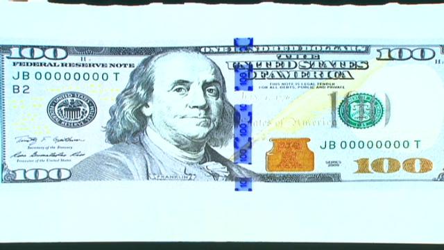 canadian 2 dollar bill back. new 100 dollar bill back.