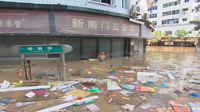 China says controversial dam standing firm amid flooding ...