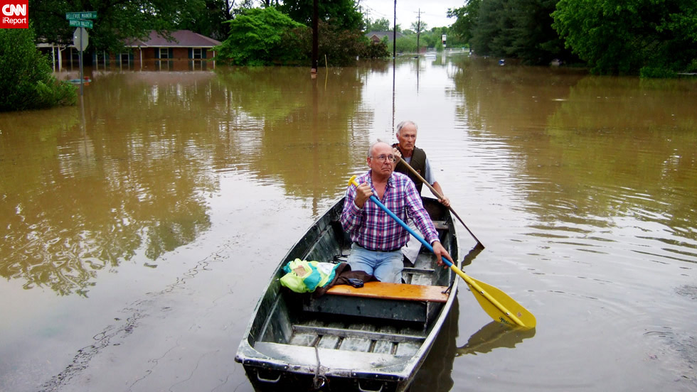 Nashville residents paddle down a flooded street on Sunday, May 2, after heavy rains. (Photo by John Rives)