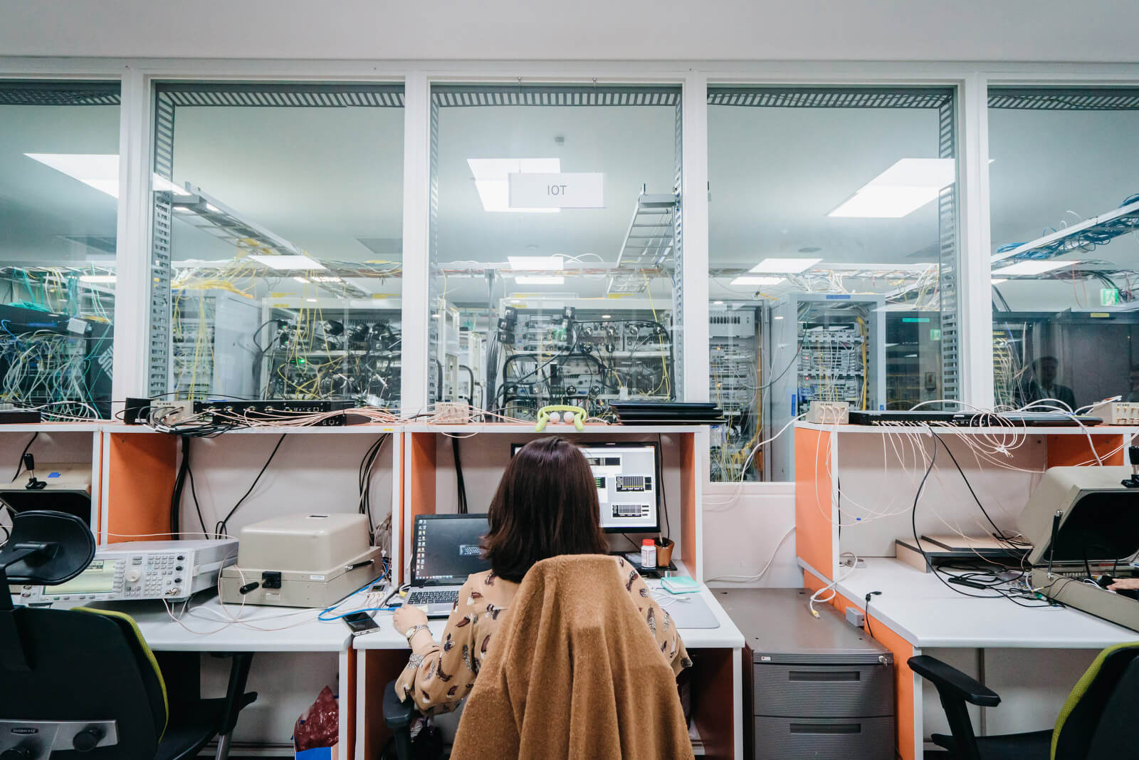 Engineers monitor network traffic and status at a 5G connectivity lab at Samsung headquarters.