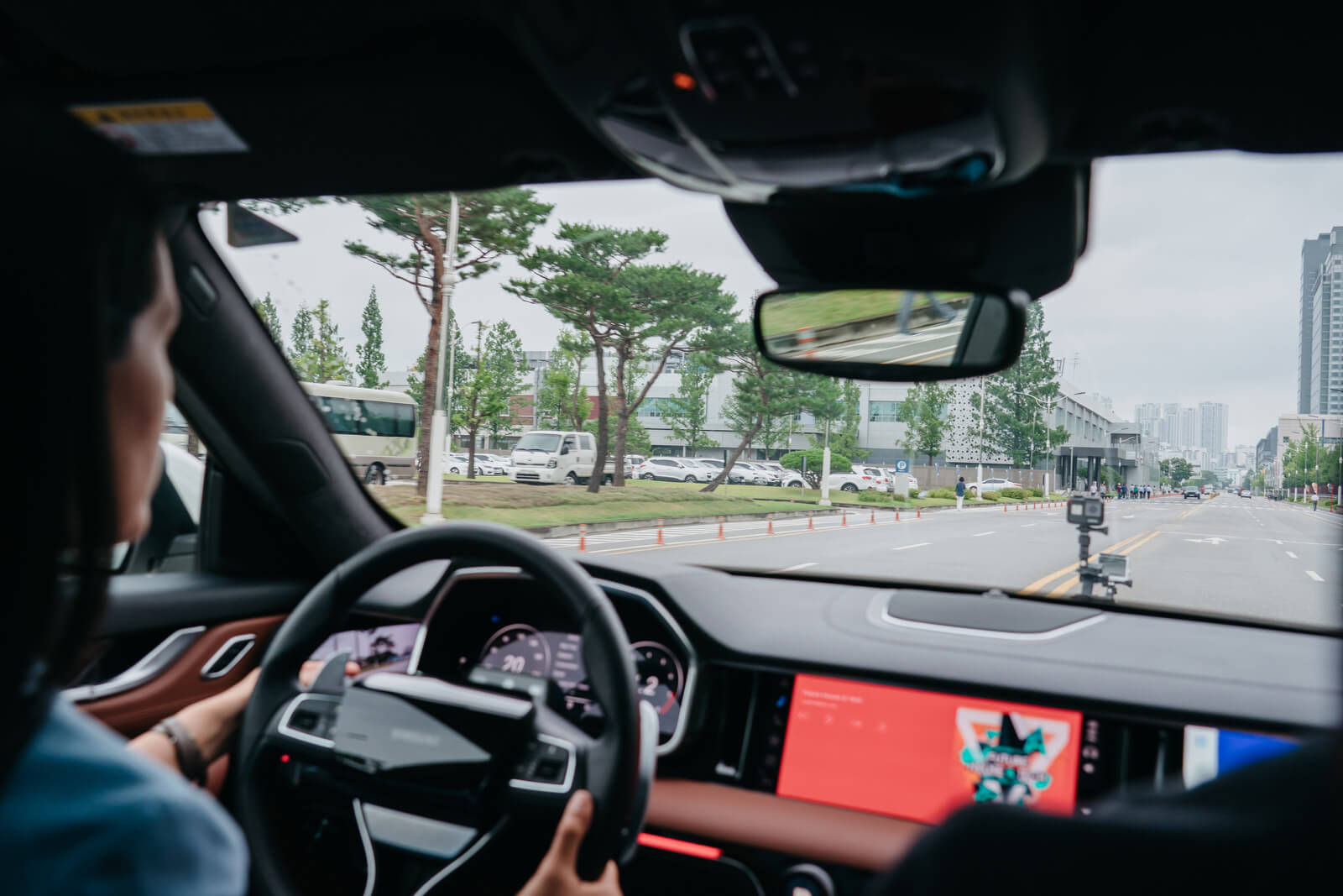 CNN's Kristie Lu Stout drives a smart vehicle equipped with Samsung's Digital Cockpit 2.0 technology.