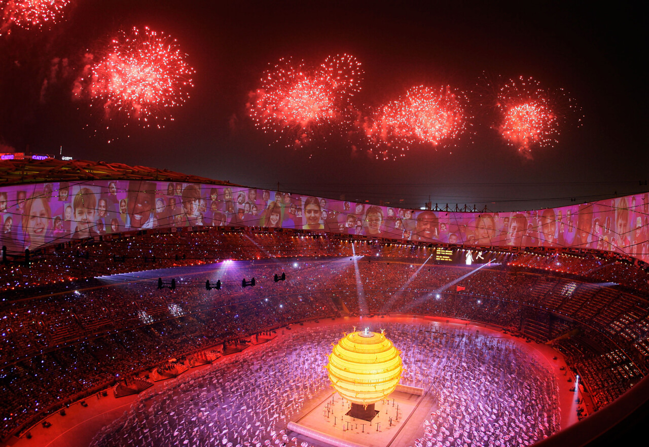 """Fireworks explode over the National Stadium during the opening ceremony of the Beijing 2008 Olympics held under the slogan """"One World, One Dream."""""""