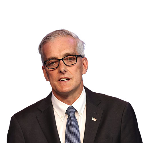 A photo of Denis McDonough from the shoulders up.